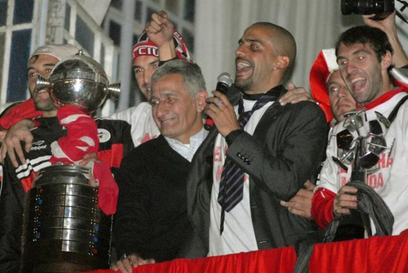 Juan Sebastian Veron (second from right) takes part in a victory celebration in La Plata, Argentina, on July 16, 2009, after his team, Argentine club Estudiantes, won the Copa Libertadores, South America's premier club soccer tournament. Alongside him is his father Juan Ramon (second from left), who starred for that club in the 1960s and early 1970s and won three Copa Libertadores titles. The Verons are the most successful father-and-son duo in Copa Libertadores history in terms of titles won. EPA-EFE/Javier Brusco/File