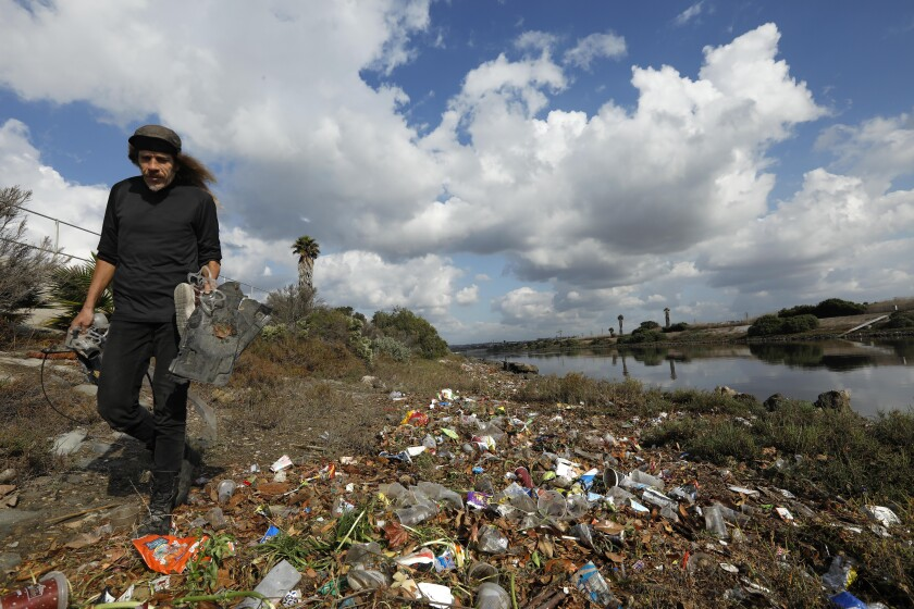 Josey Peters collects trash along Ballona Creek.