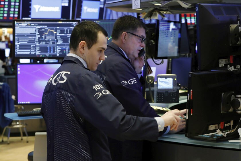 A pair of specialists prepare for the day's trading activity on the floor of the New York Stock Exchange, Monday, March 2, 2020. Wall Street is set to post more losses at the opening bell, coming on top of last week's drop, which was the worst since the global financial markets over a decade ago. (AP Photo/Richard Drew)