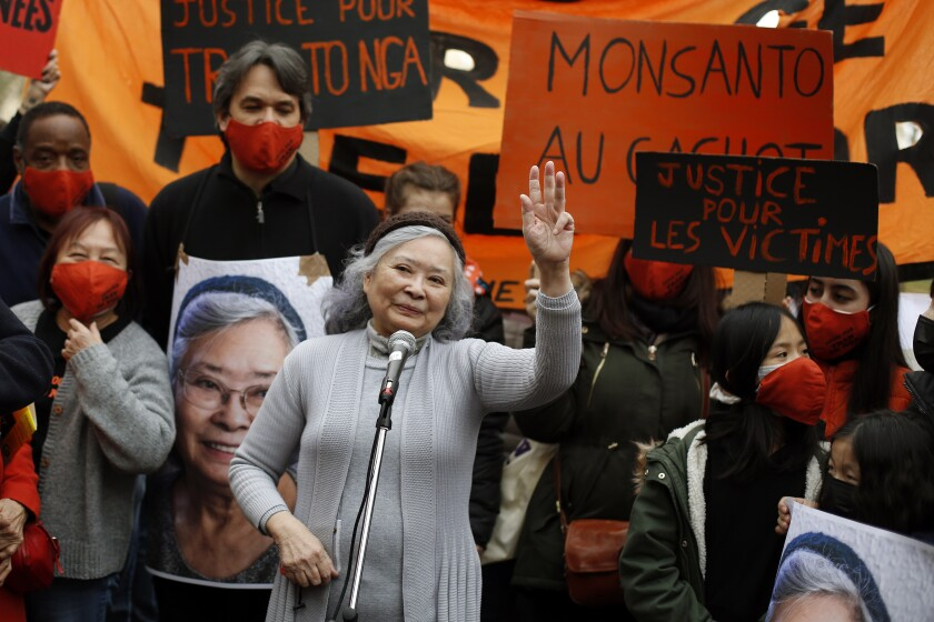 FILE - In this Jan.30, 2021 file photo, Tran To Nga waves as she delivers a speech during a gathering in support of people exposed to Agent Orange during the Vietnam War, in Paris. A French court dismissed on Monday the case of a French-Vietnamese woman who sued 14 companies that produced and sold the powerful defoliant dioxin Agent Orange used by U.S. troops during the Vietnam War, her lawyers said. Tran To Nga, a 79-year-old former journalist, will appeal the decision, according to her legal team.(AP Photo/Thibault Camus, File)