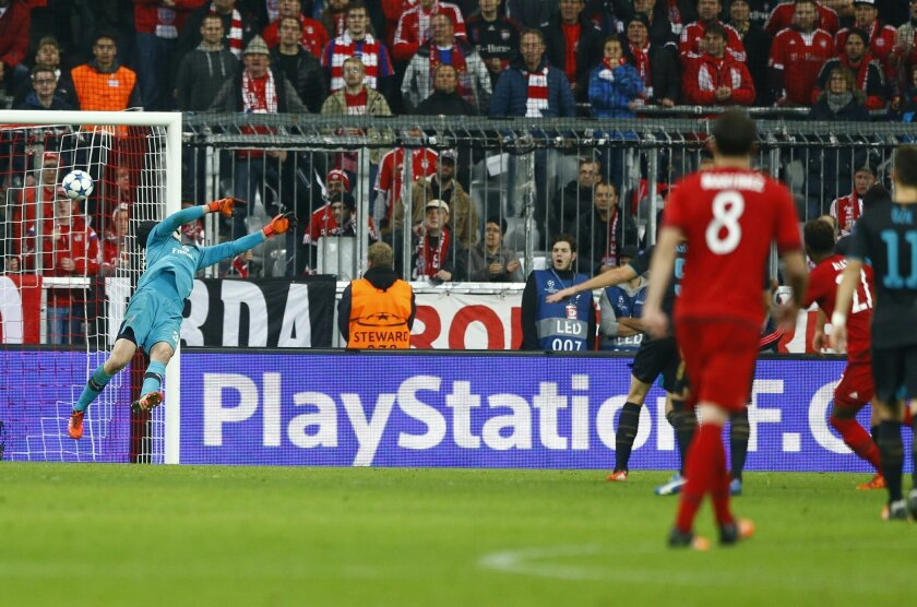 Bayern's David Alaba, second right, scores his side's third goal during the Champions League Group F soccer match between Bayern Munich and Arsenal FC in Munich, southern Germany, Wednesday, Nov. 4, 2015. (AP Photo/Matthias Schrader)