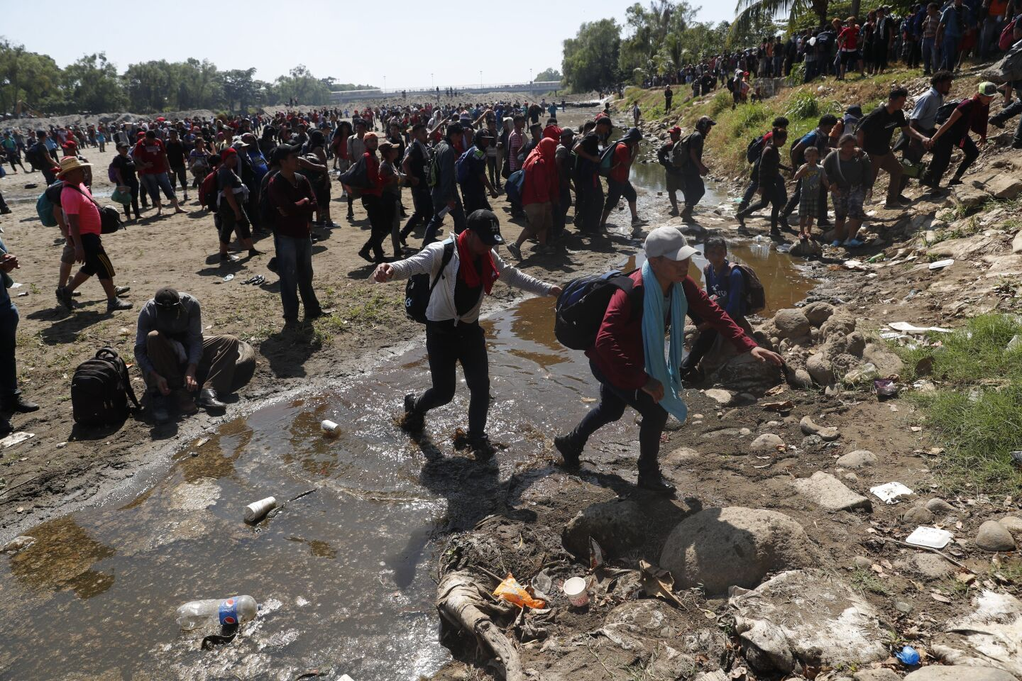 Mandatory Credit: Photo by Esteban Biba/EPA-EFE/REX (10531237n) Hundreds of Central American migrants, mostly Hondurans, cross the Suchiate River that divides Mexico and Guatemala, from the city of Tecun Uman, Guatemala, 20 January 2020. A migrant caravan consisting of Central Americans at the border of Guatemala announced that they would postpone their crossing from 19 to 20 January because they still wait for other partners, with whom they estimate to add between 5,000 and 8,000 people. Migrants cross into Mexico along the Suchíate river after denial of entry, Tecun Uman, Guatemala - 20 Jan 2020 ** Usable by LA, CT and MoD ONLY **