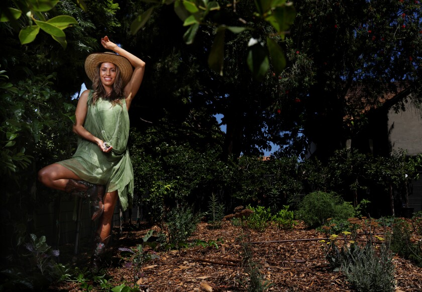 Instagram-famous wellness guru Rainbeau Mars in her Venice edible garden