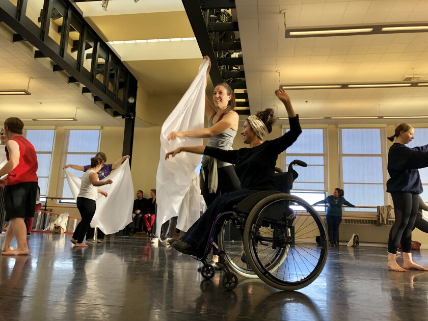 Performers in the thisABILITY group rehearse a number.