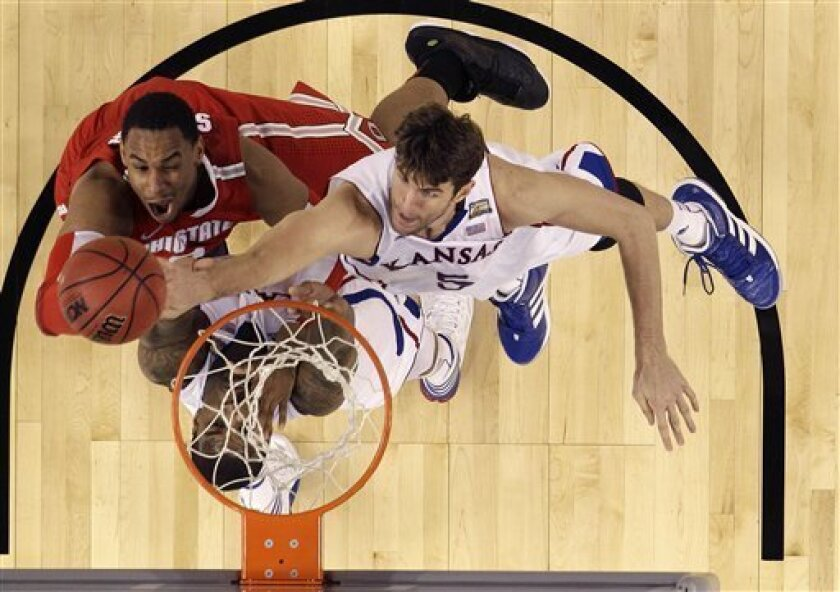 Kansas center Jeff Withey (5) battles with Ohio State forward Jared Sullinger (0) during the second half of an NCAA Final Four semifinal college basketball tournament game Saturday, March 31, 2012, in New Orleans. (AP Photo/David J. Phillip)
