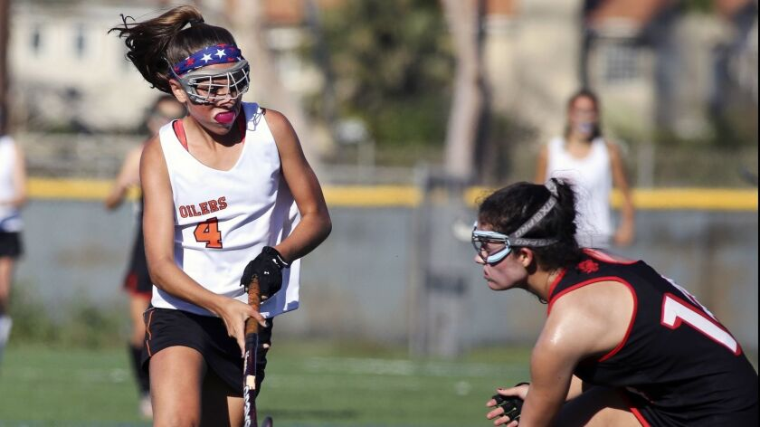 Huntington Beach's Stella Ziegler challenges a Harvard-Westlake defender in the Los Angeles Field Ho