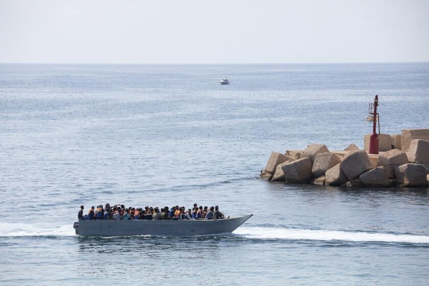 Migrants arrive at the Lampedusa island, Italy, Sunday, Oct. 3, 2021. (Sea-Watch.org/David.Lohmueller via AP)