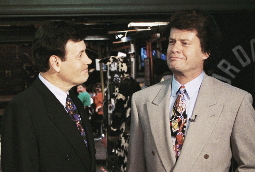 "Hair Club founder Sy Sperling and actor Kelsey Grammer appear in a ""Saturday Night Live"" segment in 1994."