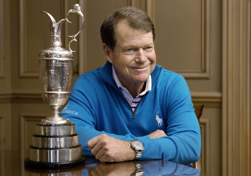 Tom Watson poses next to the Claret Jug, the trophy given to the winner of the British Open.