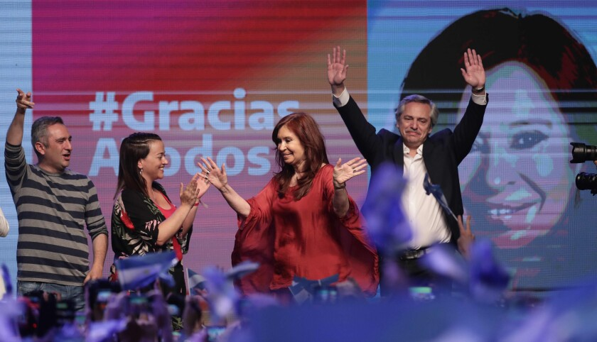 Argentina's President-elect Alberto Fernandez, right, and Vice President Cristina Fernandez wave to supporters at the party's headquarters in Buenos Aires on Sunday.