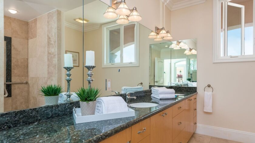Clean, uncluttered, well-appointed master bathrooms increase a home's appeal. Credit: Coldwell Ban