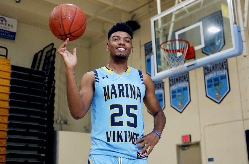 Marina High senior guard Jakob Alamudun is the Dream Team Boys' Basketball Player of the Year. Alamu