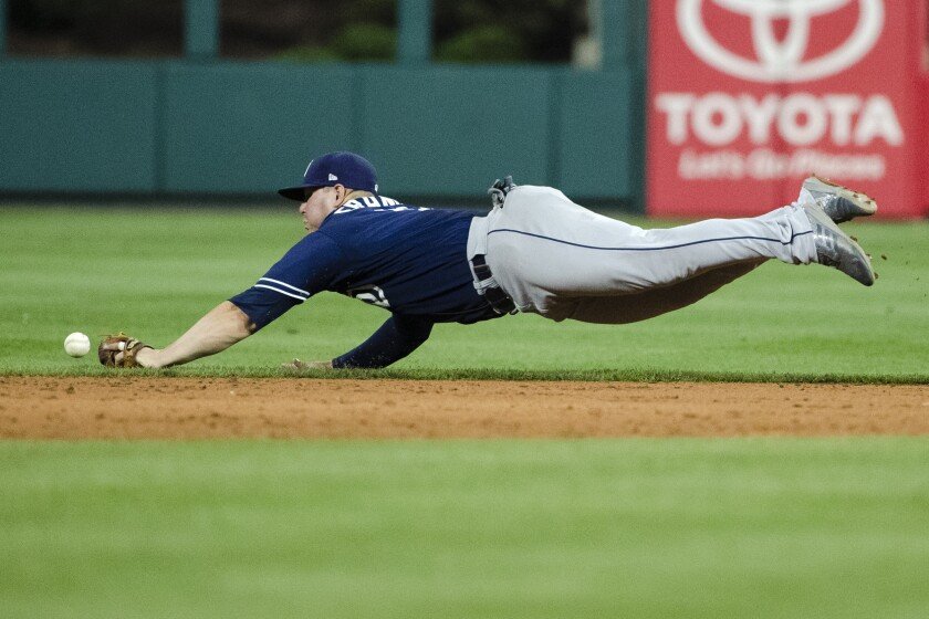 Padres second baseman Ty France can't get to a single by the Phillies' Jean Segura in the sixth inning of Friday's game at Citizens Bank Park.