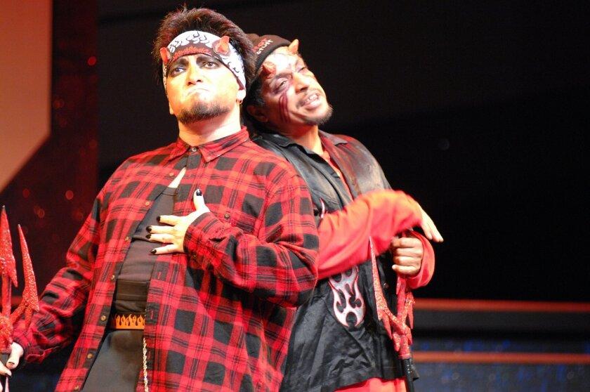 """Dave Rivas as Satan and Rhys Greene as Moloch in Teatro Mascara Magica's """"La Pastorela del Cielo"""" at Lyceum Theatre."""