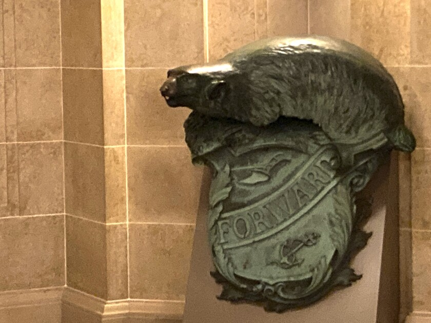 A Badger and Shield statue is seen outside the governor's Capitol office in Madison, Wis., Wednesday, Jan. 27, 2021. On loan for more than 30 years, the U.S. Naval Academy wants the state of Wisconsin to return the statue. The Navy wants to include it in an exhibit featuring the USS Wisconsin battleship in Norfolk, Va. State historians are fighting to keep the statue in the state for another two years. (AP Photo/Todd Richmond)