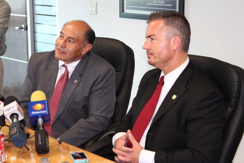 Sen. Lou Correa, D-Anaheim and Assembly member Travis Allen, D-Huntington Beach, address reporters at the Tijuana Economic Development Corporation on Tuesday.