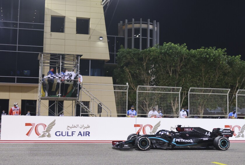 Mercedes driver Lewis Hamilton of Britain wins the Formula One Bahrain Grand Prix in Sakhir, Bahrain, Sunday, Nov. 29, 2020. (Giuseppe Cacace, Pool via AP)