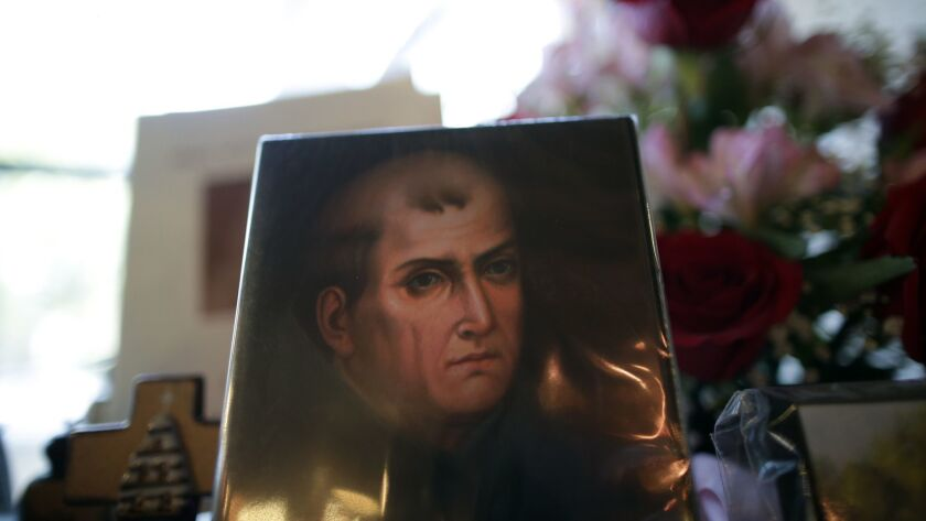 File - In this Jan. 27, 2015 file photo, a portrait of Franciscan missionary Junipero Serra can be s