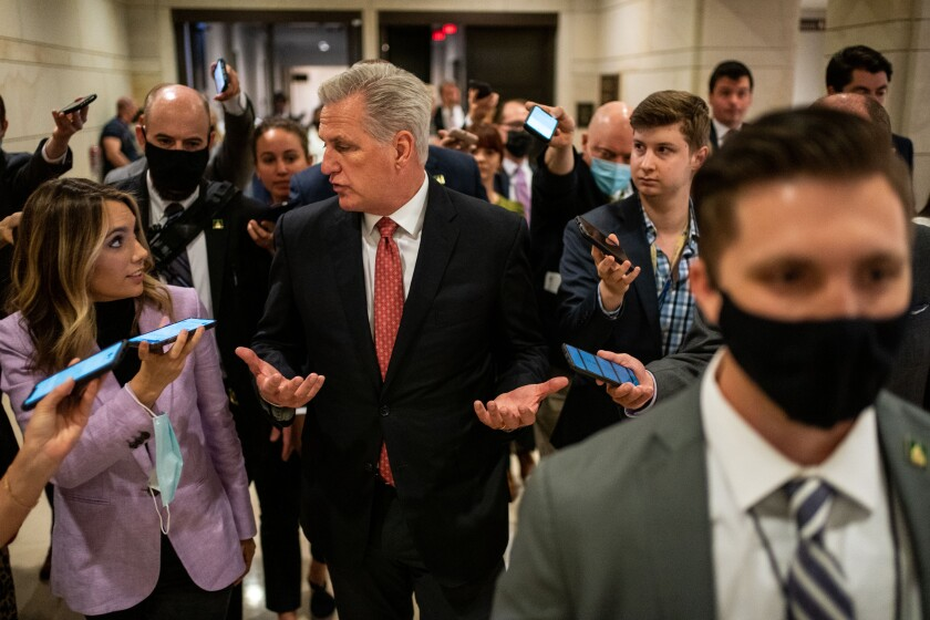 House Minority Leader Kevin McCarthy is surrounded by reporters.