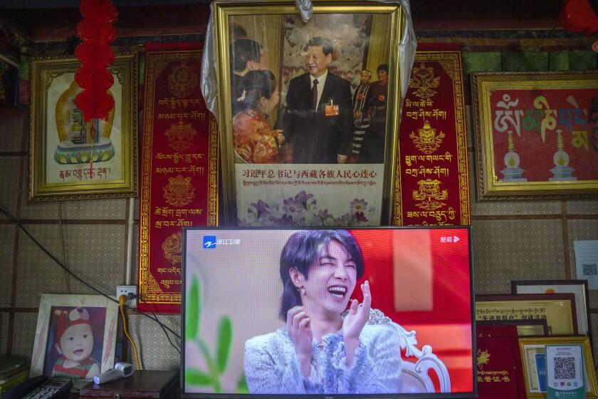 TV below portrait of China's president
