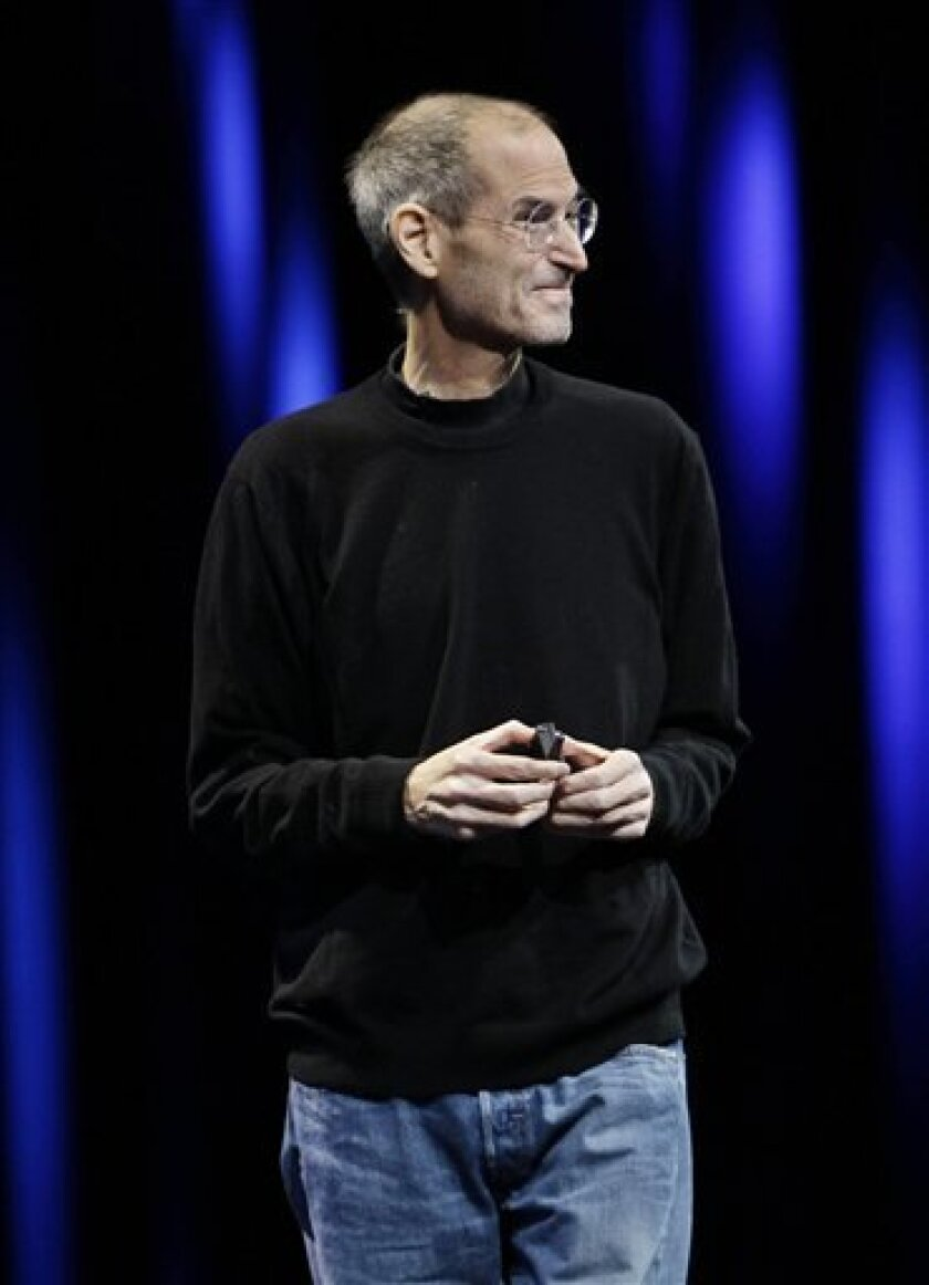 Apple CEO Steve Jobs smiles as he is applauded during a keynote address to the Apple Worldwide Developers Conference in San Francisco, Monday, June 6, 2011. (AP Photo/Paul Sakuma)