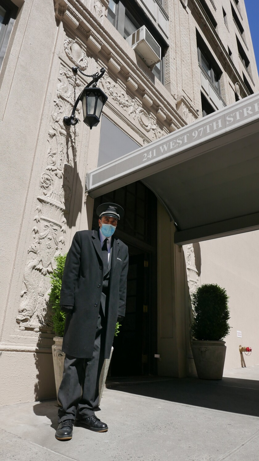 """""""I love serving the people of New York,"""" said DeJesus, who has worked as a doorman for 25 years."""