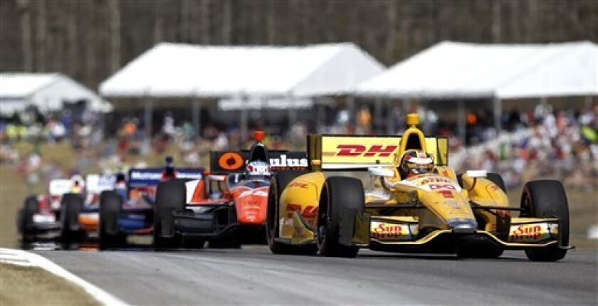 Ryan Hunter-Reay (1) leads the pack down the back stretch during the IndyCar Series Grand Prix of Alabama auto race in Birmingham, Ala., Sunday, April 7, 2013. (AP Photo/Butch Dill)