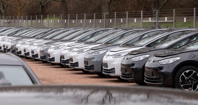 FILE - In this Tuesday, Feb. 25, 2020 file photo, Electric car ID.3 cars stand at the factory area during a press tour at the plant of the German manufacturer Volkswagen AG ,VW, in Zwickau, Germany. Automaker Volkswagen tripled sales of battery-only cars last year as its new electric compact ID.3 came on the market ahead of tough new limits on auto emissions. (AP Photo/Jens Meyer, file)