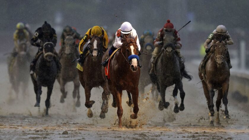 Mike Smith rides Justify to victory during the 144th running of the Kentucky Derby horse race at Chu