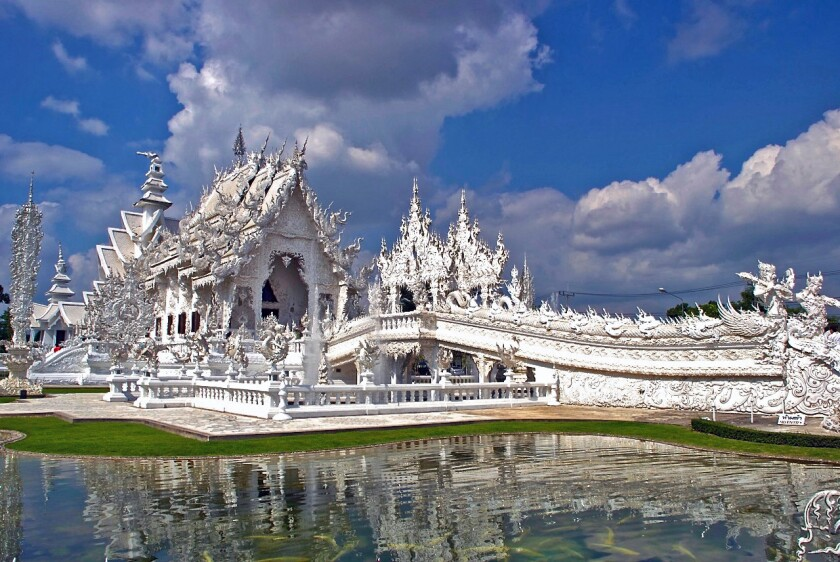 The White Temple, a Gaudi-esque Buddhist sanctuary, sparkles a few miles outside of Chiang Rai in northern Thailand. The structure is the brainchild of visual artist and designer Chalermchai Kositpipat, who began working on his self-funded masterpiece in 1997.