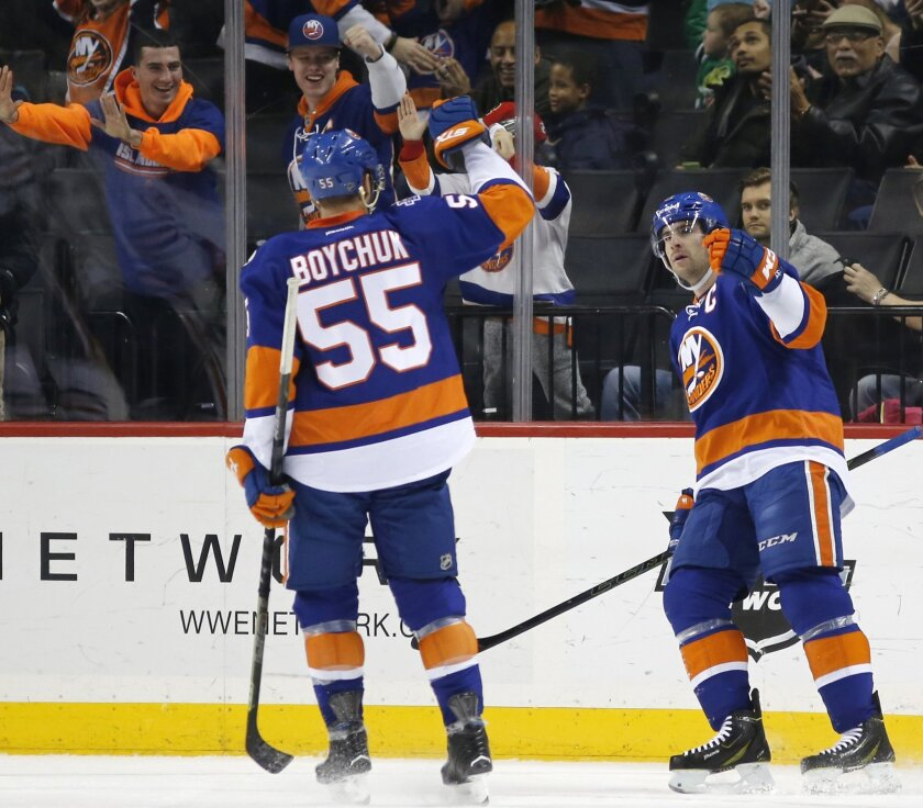 New York Islanders defenseman Johnny Boychuk (55) and Islanders center John Tavares (91) celebrate after Tavares scored a goal against the Edmonton Oilers in the first period of an NHL hockey game in New York, Sunday, Feb. 7, 2016. Boychuk also scored one of three Islanders goals in the period. (AP