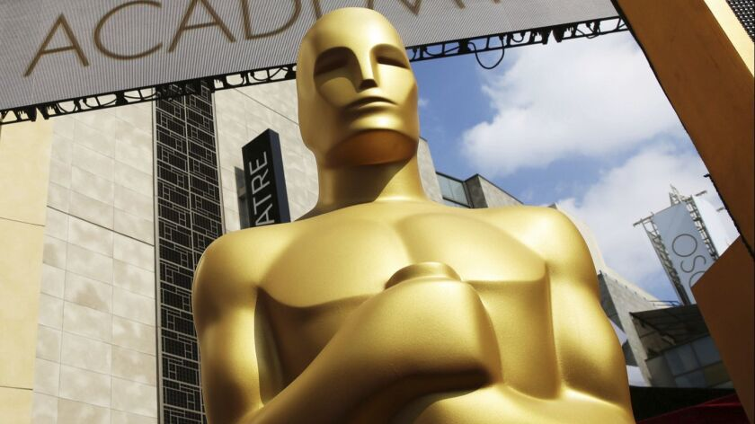 An Oscar statue installed outside the Dolby Theatre for the 87th Academy Awards in Los Angeles.