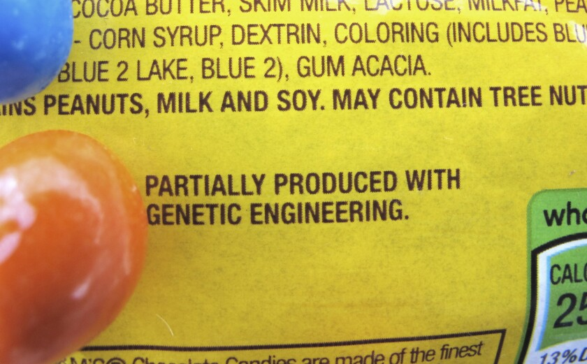 "A new disclosure statement on a package of Peanut M&M's candy in Montpelier, Vt. identifies them as being ""partially produced with genetic engineering."""