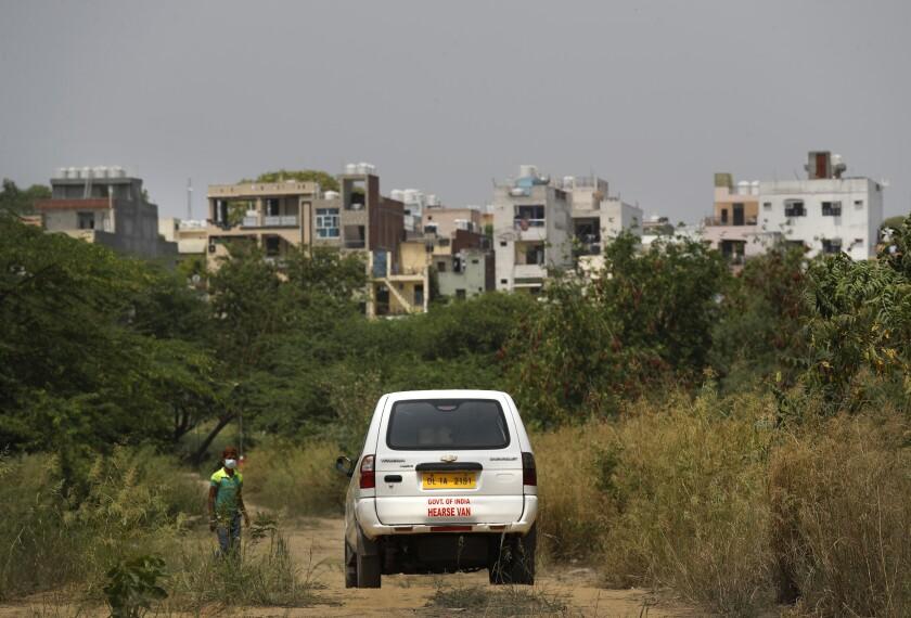 Virus Outbreak India Burial Photo Gallery
