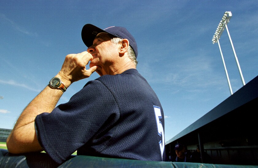 Sam Suplizio watches from the dugout during a spring training game between the Angels and Oakland Athletics.