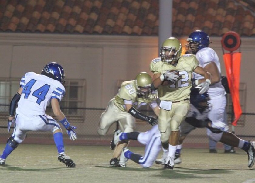 The Bishop's School's Jake Seau runs the ball against the Torreys on Saturday night. Phil dailey photo