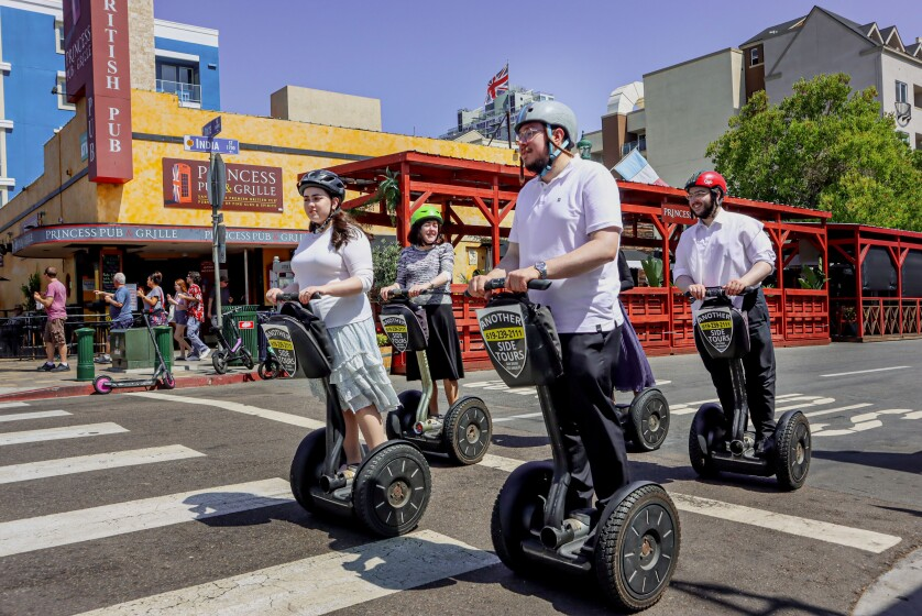 Tourists on a Segway tour along India Street in Downtown San Diego on Tuesday, July 27, 2021.