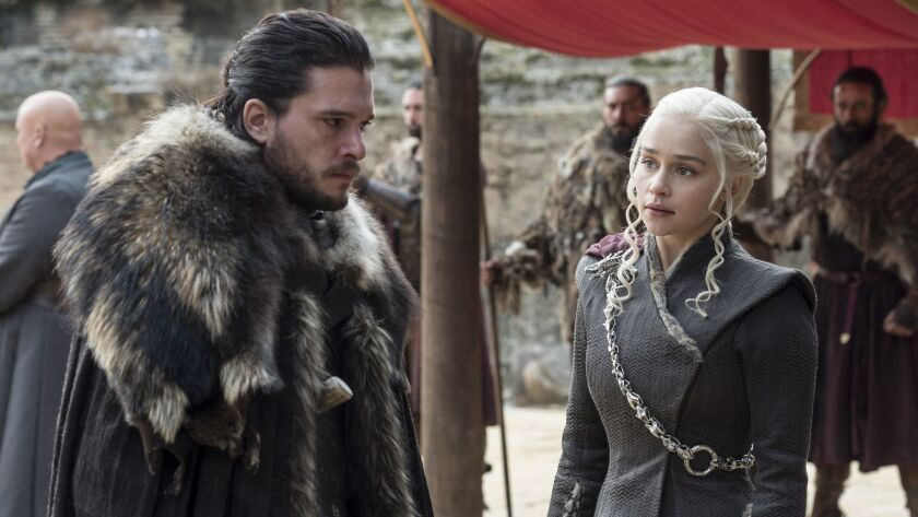 """This image released by HBO shows Kit Harington, left, and Emilia Clarke on the season finale of """"Gam"""