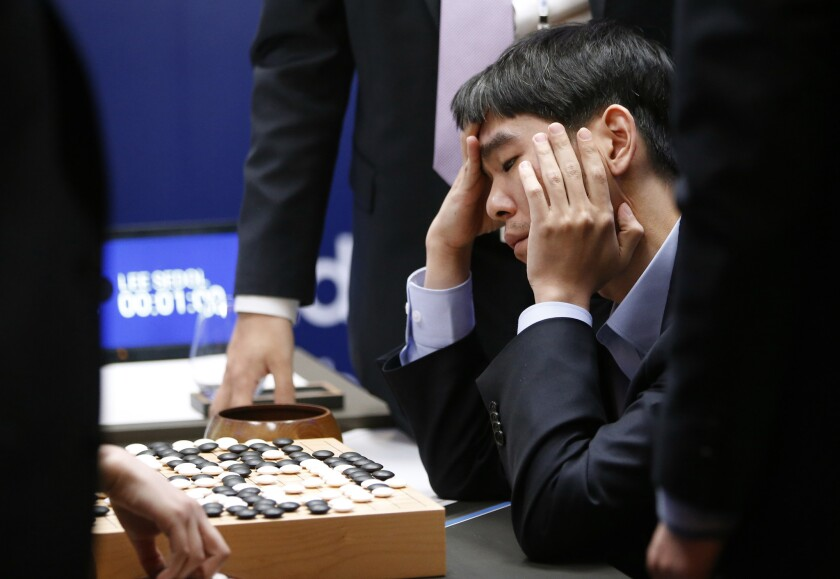 South Korean Go player Lee Sedol reviews the match after finishing the Google DeepMind Challenge Match against Google's artificial intelligence program, AlphaGo, in Seoul, South Korea, on March 15, 2016. Google's Go-playing computer program defeated its human opponent in a 4:1 victory.