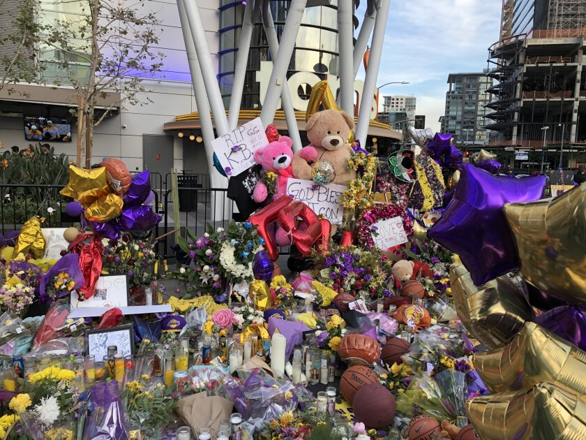 Tributes to Kobe Bryant, his daughter Gianna and the other seven victims of a helicopter crash Sunday that killed the Lakers legend are seen outside Staples Center and L.A. Live.