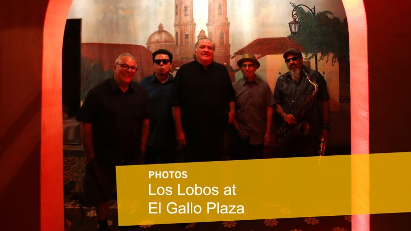 """Los Lobos members Conrad Lozano, left, Cesar Rosas, David Hidalgo, Louie Perez and Steve Berlin before performing an intimate concert for family and friends to celebrate their new album, """"Gates of Gold,"""" at El Gallo Plaza in East Los Angeles on Sept. 29."""