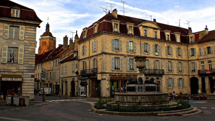 """Fronted by many of the """"newer"""" buildings in Arbois (only 250 years old), the central Place de la Lib"""
