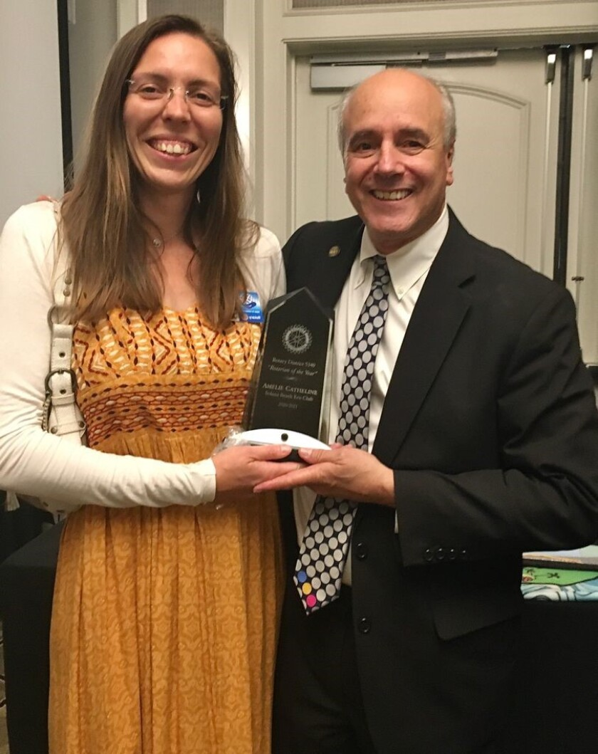 Amélie Catheline, Ph.D. receives her award from Steve Weitzen, District Governor of Rotary District 5340.