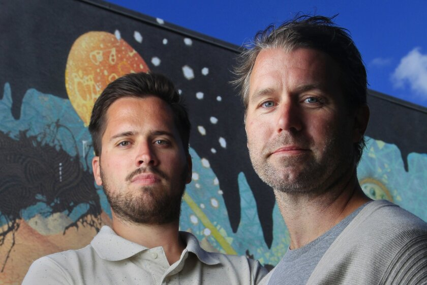 Brian Jenkins (left), owner of Riot House Records, and Rick Tyner, manager of M-Theory Records, stand outside M-Theory Records.