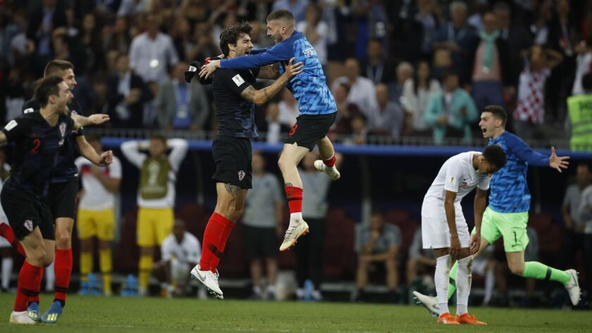 Players of Croatia celebrate after the semifinal match between Croatia and England at the 2018 socce