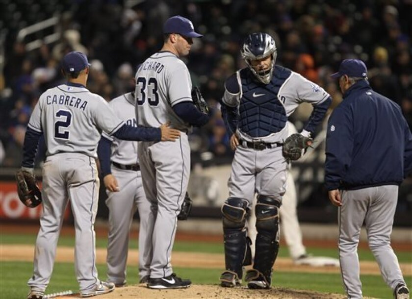 San Diego Padres shortstop Everth Cabrera pats starting pitcher Clayton Richard as manager Bud Black approaches to remove the pitcher from his first start of 2013 in New York. Richard will start the home opener Tuesday. (AP Photo/Peter Morgan)