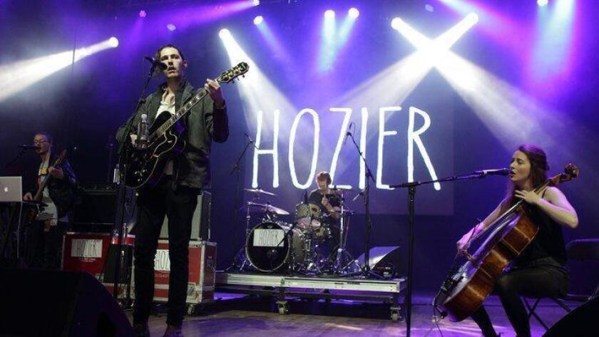 "FILE - In this May 10, 2014 file photo, Andrew Hozier-Byrne of the band Hozier performs in concert during the Sweetlife Festival at Merriweather Post Pavilion in Columbia, Md. Hozier's ""Take Me To Church"" from Columbia Records is the most streamed track in the U.S. on Spotify, based on the number of people who shared it divided by the number who listened to it, from Monday, Dec. 22, 2014 to Sunday Dec. 28 via Facebook, Tumblr, Twitter and Spotify. (Photo by Owen Sweeney/Invision/AP, File) (/ The Associated Press)"