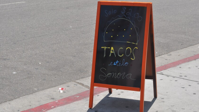 A sign out front simply advertises $2 tacos at Sonoratown in downtown Los Angeles.
