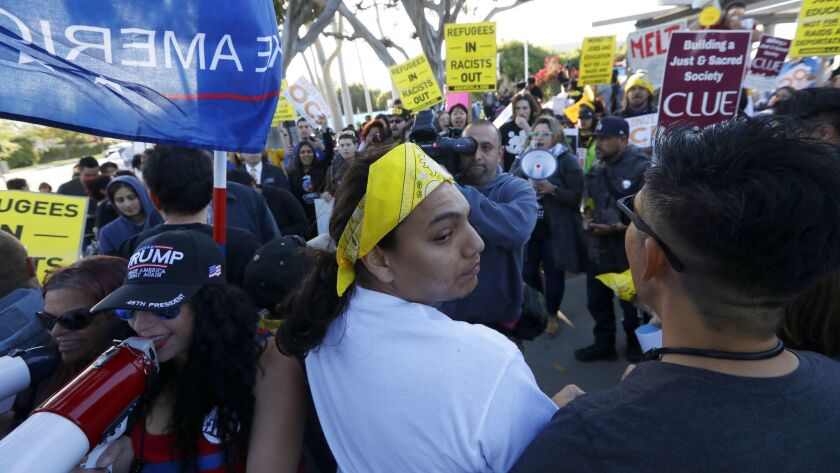 Los Alamitos, CA April 16, 2018: Pro immigrant activisits form a line and turn their backs as the