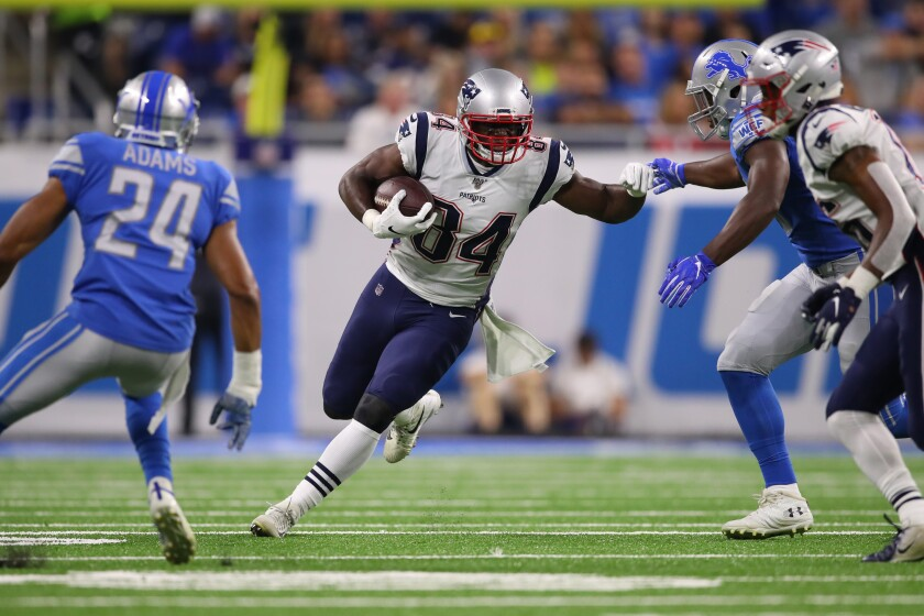 New England Patriots' Benjamin Watson (84) looks for yards after a second quarter catch while playing the Detroit Lions during a preseason game on Thursday in Detroit.